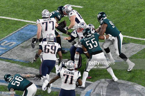 Brandon Graham of the Philadelphia Eagles forces Tom Brady of the New England Patriots to fumble during the fourth quarter in Super Bowl LII at US...