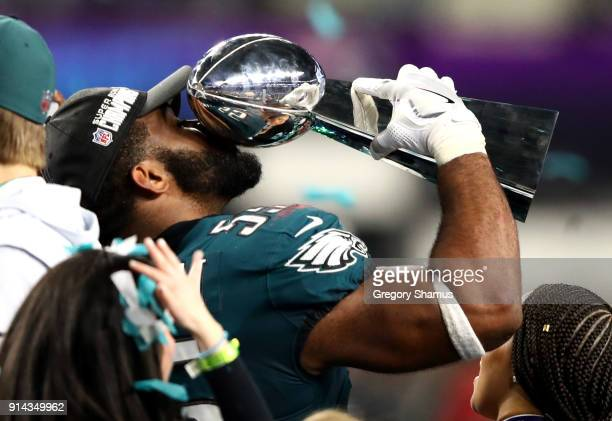 Brandon Graham of the Philadelphia Eagles kisses the Lombardi trophy after defeating the New England Patriots 4133 in Super Bowl LII at US Bank...