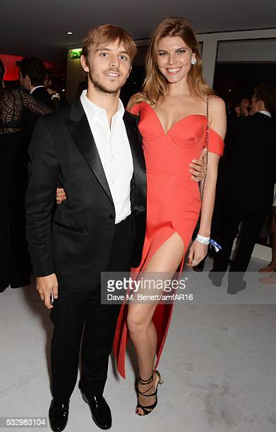 Brandon Green and guest attend the after party for amfAR's 23rd Cinema Against AIDS Gala at Hotel du CapEdenRoc on May 19 2016 in Cap d'Antibes France