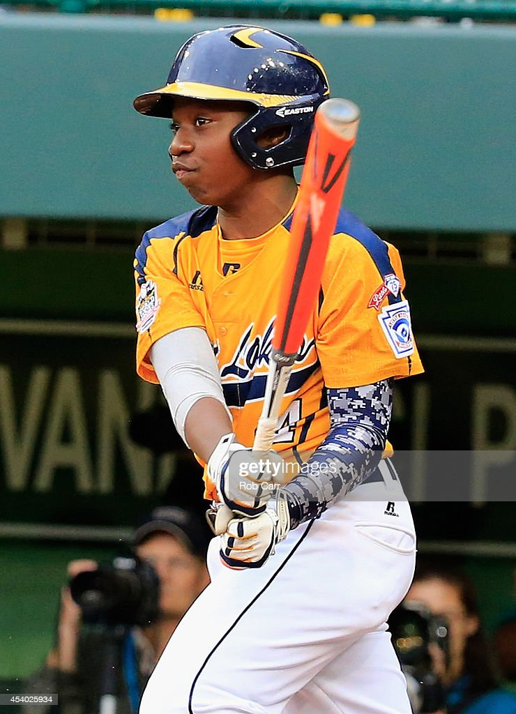 Brandon Green #14 of the Great Lakes Team from Chicago, Illinois follows his RBI hit against the West Team from Las Vegas, Nevada against during fifth inning of the United States Championship game of the Little League World Series at Lamade Stadium on August 23, 2014 in South Williamsport, Pennsylvania. Great Lakes won 7-5.