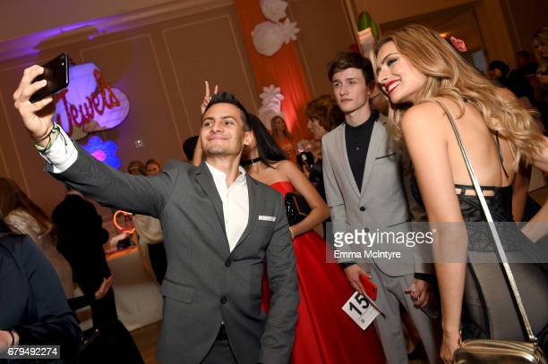 Brandon Guerro Actor Emily Tosta and Influencers Crawford Collins and Kirsten Collins attend the 24th Annual Race To Erase MS Gala at The Beverly...