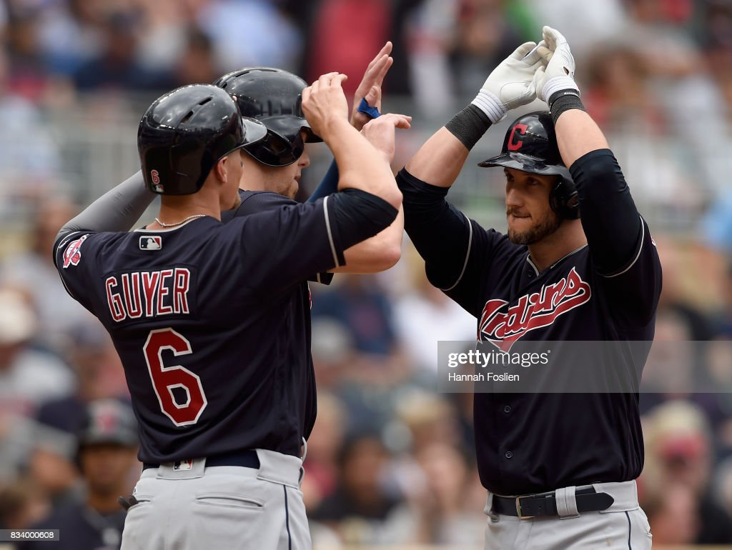 Brandon Guyer #6 and Bradley Zimmer #4 of the Cleveland Indians congratulate teammate Yan Gomes #7 on a three-run home run against the Minnesota Twins during the eighth inning in game one of a doubleheader on August 17, 2017 at Target Field in Minneapolis, Minnesota. The Indians defeated the Twins 9-3.