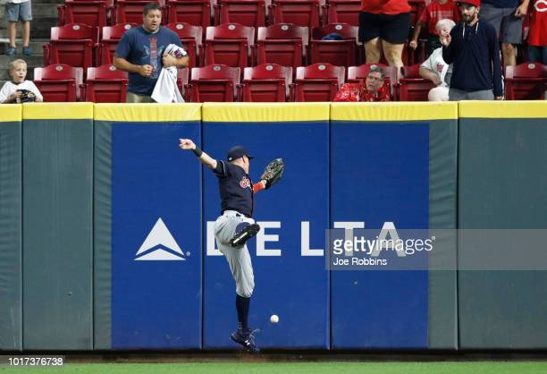 Brandon Guyer of the Cleveland Indians allows the ball to get over his head after a hit by Jose Peraza of the Cincinnati Reds in the ninth inning at...