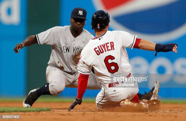 Brandon Guyer of the Cleveland Indians steals second base safely against Didi Gregorius of the New York Yankees in the fifth inning at Progressive...