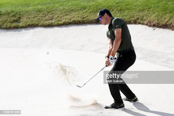 Brandon Hagy of the United States hits from a bunker on the 15th hole during the final round of the Honda Classic at PGA National Resort and Spa...