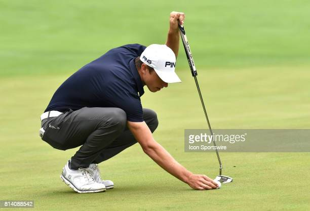 Brandon Hagy places his ball for a putt on the No 1 hole during the first round of the John Deere Classic July 13 at TPC Deere Run Silvis IL