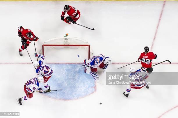 Brandon Halverson of the New York Rangers makes a save as team mates Brady Skjei Pavel Buchnevich and Neal Pionk defend against Marian Gaborik Matt...