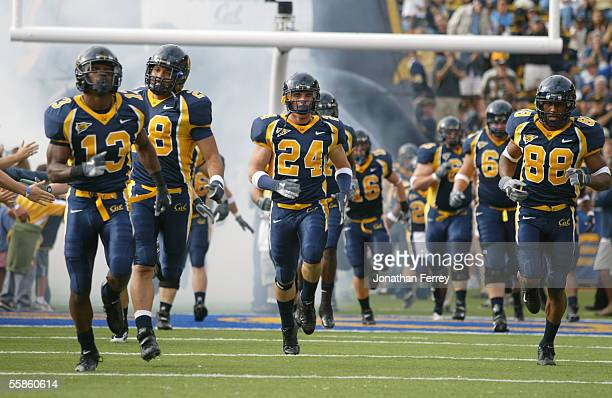 Brandon Hampton Kenny Frank Kenny Green Eddie Young of the California Golden Bears run onto the field before the game against the Arizona Wildcats on...
