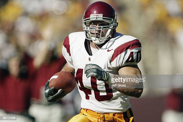 Brandon Hancock of the USC Trojans carries the ball for a 33yard touchdown against the Arizona State Sun Devils in the third quarter of the game on...