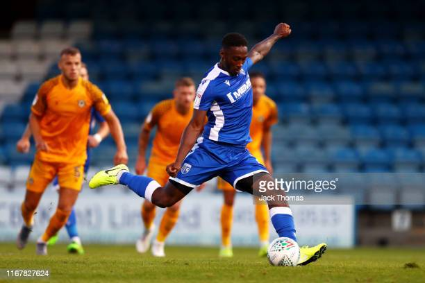 Brandon Hanlan of Gillingham FC scores his team's first goal from the penalty spot during the Carabao Cup First Round match between Gillingham and...