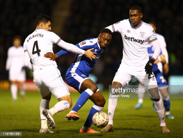 Brandon Hanlan of Gillingham is challenged by Fabian Balbuena of West Ham United during the FA Cup Third Round match between Gillingham FC and West...