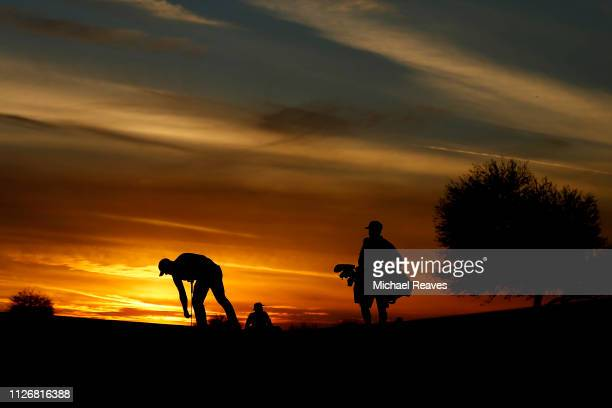 Brandon Harkins looks over a putt on the ninth green during the second round of the Waste Management Phoenix Open at TPC Scottsdale on February 01...