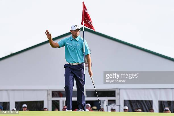 Brandon Harkins waves his ball to fans after nearly making an albatross / ace on the par 4 17th hole during the third round of the US Open at Oakmont...