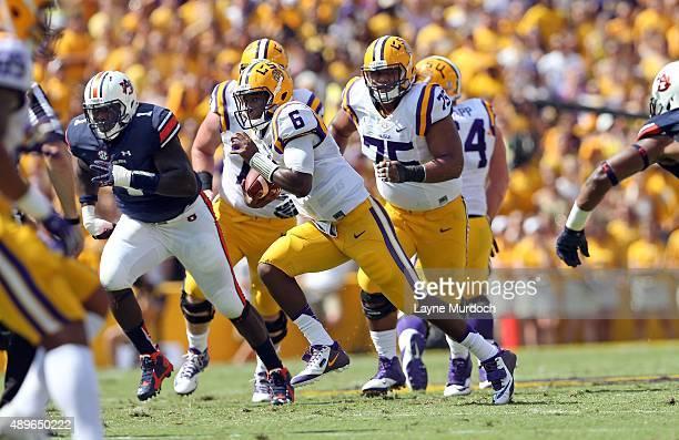 Brandon Harris of the Louisiana State University Tigers runs against Montravius Adams of the Auburn University Tigers at Tiger Stadium on September...