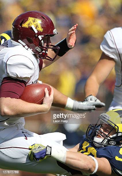 Brandon Herron of the Michigan Wolverines rushes Max Shortell of the Minneota Golden Gophers during the game at Michigan Stadium on October 1 2011 in...