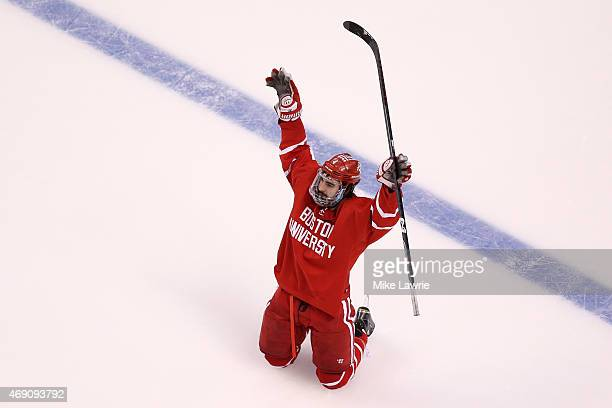 Brandon Hickey of the Boston Terriers celebrates after scoring his team's second goal on a power play against North Dakota in the first period during...