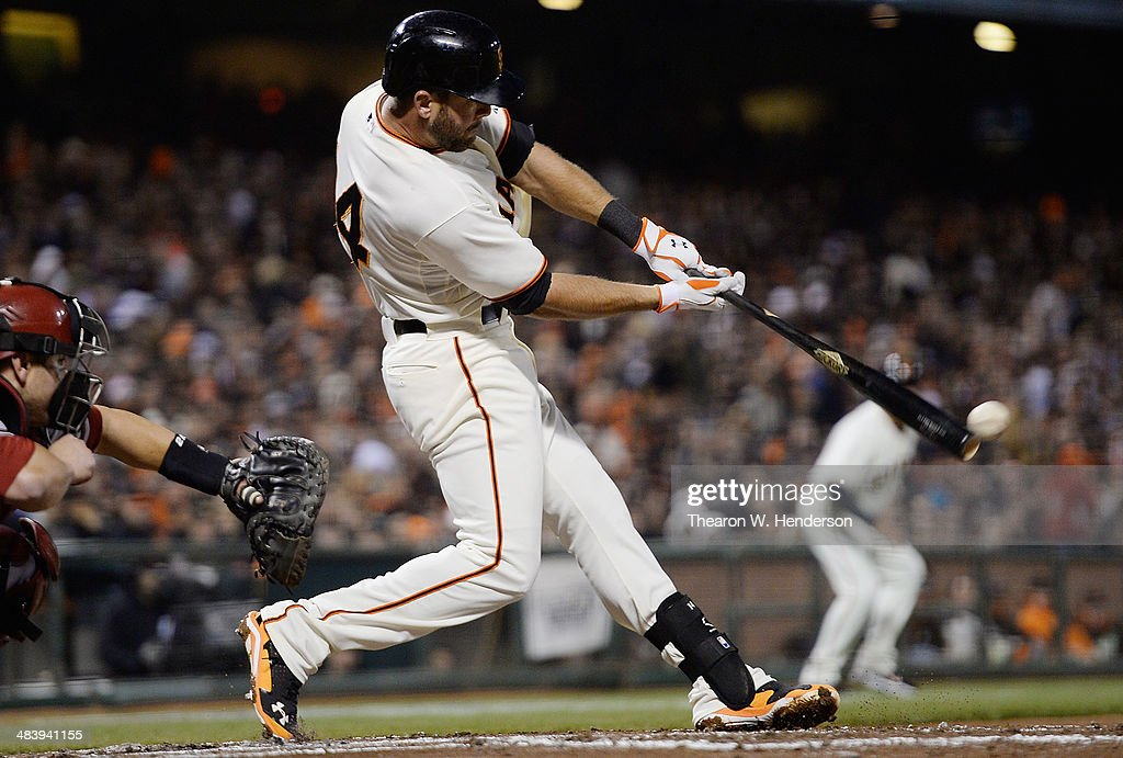 Brandon Hicks #14 of the San Francisco Giants hits an RBI single, driving in Hunter Pence #8 (not pictured) against the Arizona Diamondbacks in the bottom of the second inning at AT&T Park on April 10, 2014 in San Francisco, California.