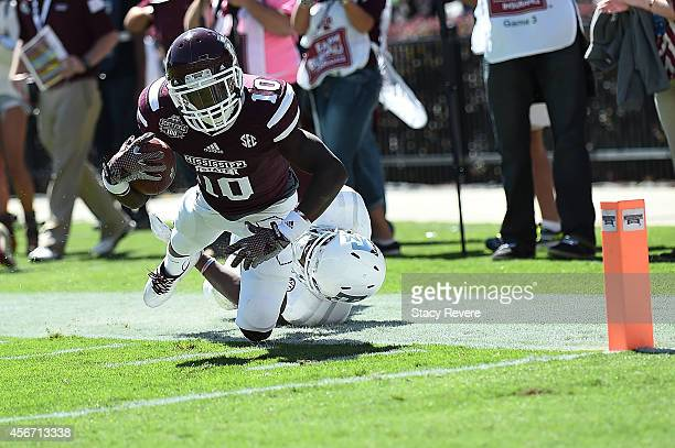 Brandon Holloway of the Mississippi State Bulldogs is brought down by Armani Watts of the Texas AM Aggies during the third quarter of a game at Davis...