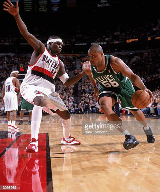 Brandon Hunter of the Boston Celtics drives to the basket against Zach Randolph of the Portland Trail Blazers during the game at The Rose Garden on...