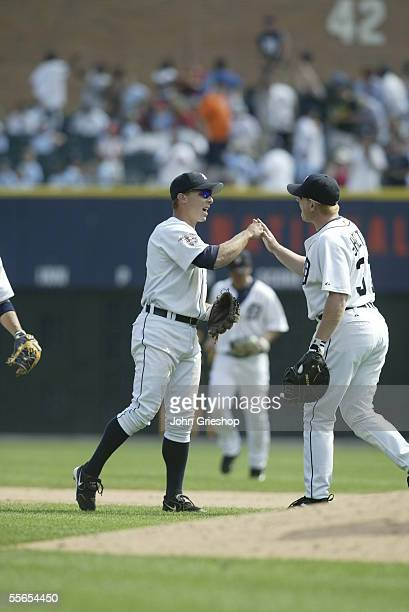 Brandon Inge and Chris Shelton of the Detroit Tigers celebrate the final out of the game against the Boston Red Sox at Comerica Park on August 17...