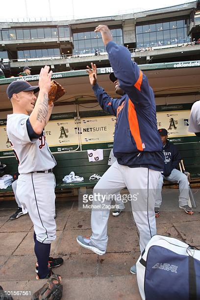 Brandon Inge and Dontrelle Willis of the Detroit Tigers doing a pregame ritual in the dugout prior to the game against the Oakland Athletics at the...