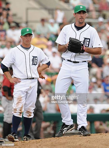 Brandon Inge and Justin Verlander of the Detroit Tigers look on while wearing green hats in honor of St. Patrick's Day during the spring training...
