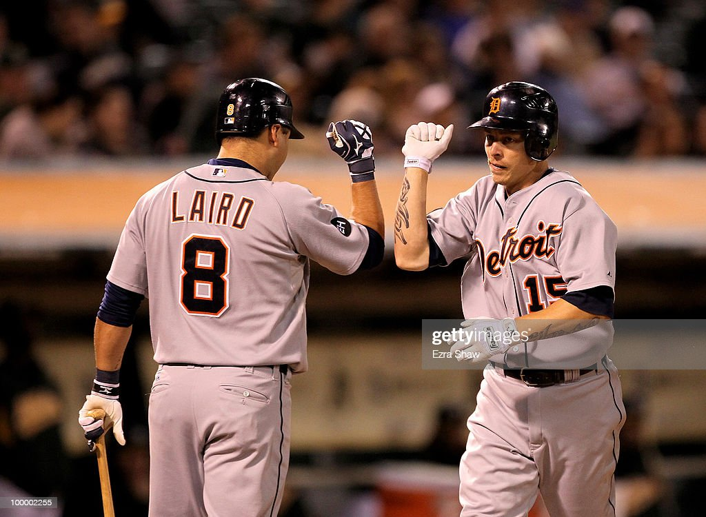 Brandon Inge #15 of the Detroit Tigers is congratulated by teammate Gerald Laird #8 after he hit a solo home run in the seventh inning of their game against the Oakland Athletics at the Oakland-Alameda County Coliseum on May 19, 2010 in Oakland, California.