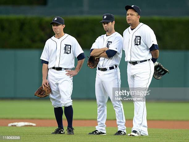 Brandon Inge Scott Sizemore and Miguel Cabrera of the Detroit Tigers look on against the Tampa Bay Rays during the game at Comerica Park on May 23...