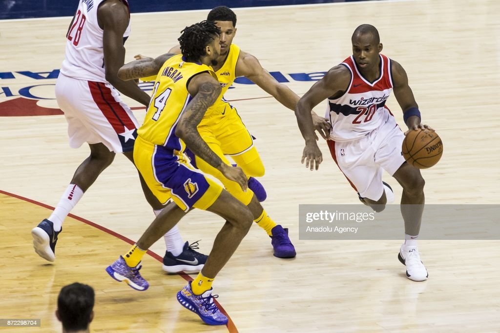 Brandon Ingram (14) and Josh Hart (2nd R) of Los Angeles Lakers in action against Jodie Meeks (R) of Washington Wizard during an NBA Game between Washington Wizards and Los Angeles Lakers at Capitol One Arena in Washington, United States on November 09, 2017.