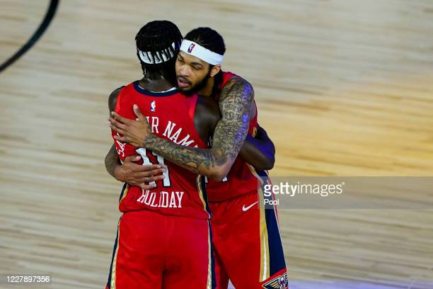 Brandon Ingram and Jrue Holiday of the New Orleans Pelicans celebrate after a 10999 win over the Memphis Grizzlies in an NBA basketball game at HP...