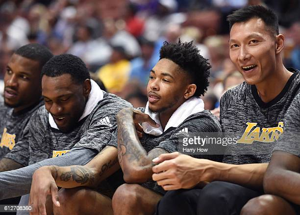 Brandon Ingram and Yi Jianlian of the Los Angeles Lakers laugh on the bench during a preseason game against the Sacramento Kings at Honda Center on...