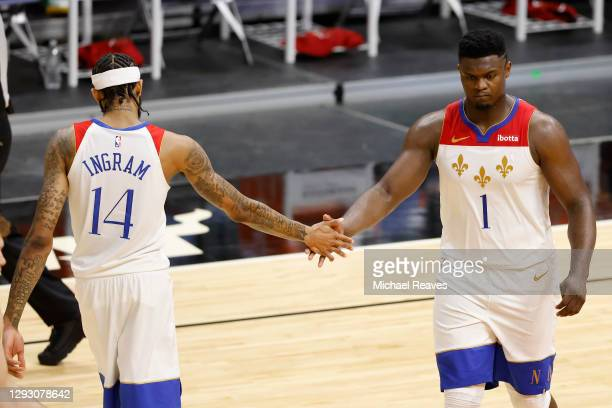 Brandon Ingram and Zion Williamson of the New Orleans Pelicans high five against the Miami Heat during the third quarter at American Airlines Arena...