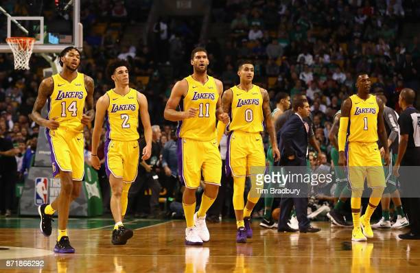Brandon Ingram Lonzo Ball Brook Lopez Kyle Kuzma and Kentavious CaldwellPope of the Los Angeles Lakers walk to the bench during a time out in the...