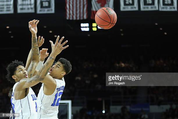 Brandon Ingram of the Duke Blue Devils and Derryck Thornton reach for a rebound during their game against the Yale Bulldogs during the second round...