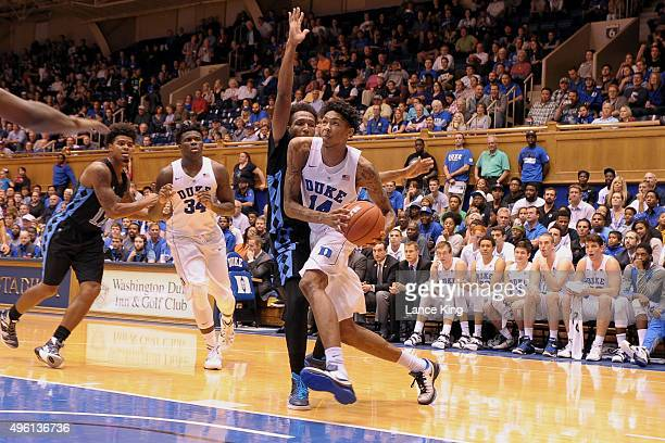 Brandon Ingram of the Duke Blue Devils drives against Ramel Belfield of the Livingstone Blue Bears at Cameron Indoor Stadium on November 4 2015 in...