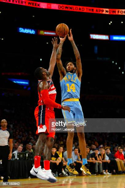 Brandon Ingram of the Los Angeles Lakers attempts a jump shot against John Wall of the Washington Wizards on October 25 2017 at STAPLES Center in Los...