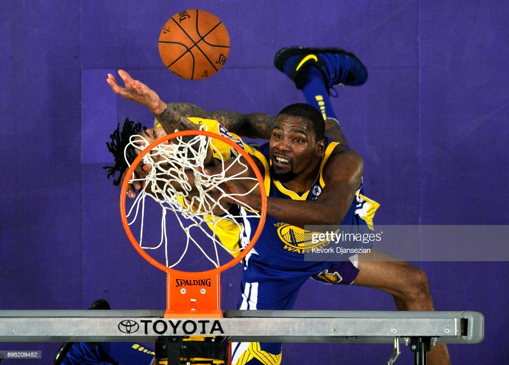 Brandon Ingram #14 of the Los Angeles Lakers blocks a slam dunk by Kevin Durant #35 of the Golden State Warriors during the second half at Staples Center on December 18, 2017 in Los Angeles, California.