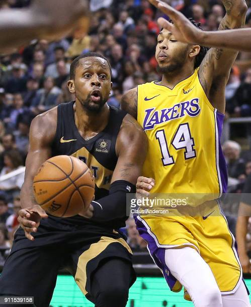 Brandon Ingram of the Los Angeles Lakers defends against CJ Miles the Toronto Raptors in an NBA game at the Air Canada Centre on January 28 2018 in...