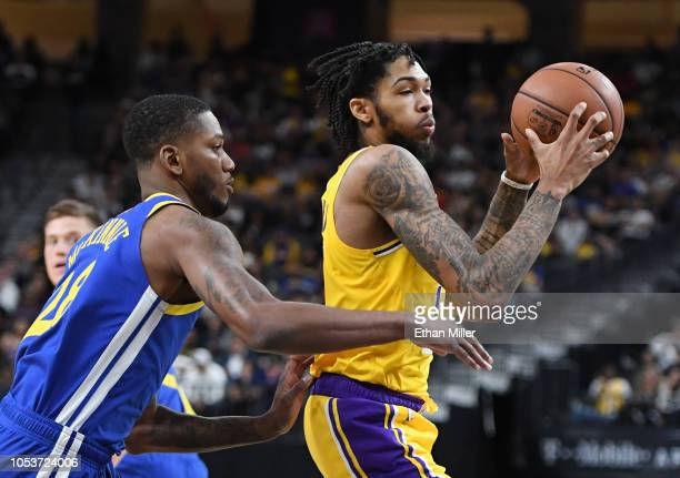 Brandon Ingram of the Los Angeles Lakers drives against Alfonzo McKinnie of the Golden State Warriors during their preseason game at TMobile Arena on...
