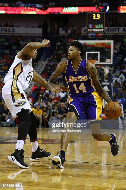 Brandon Ingram of the Los Angeles Lakers drives against Anthony Brown of the New Orleans Pelicans during the second half of a game at the Smoothie...