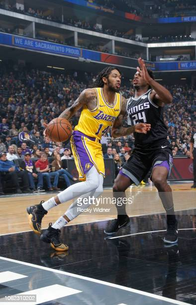 Brandon Ingram of the Los Angeles Lakers drives against Buddy Hield of the Sacramento Kings on November 10 2018 at Golden 1 Center in Sacramento...