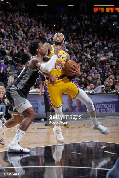 Brandon Ingram of the Los Angeles Lakers drives against Buddy Hield of the Sacramento Kings on December 27 2018 at Golden 1 Center in Sacramento...