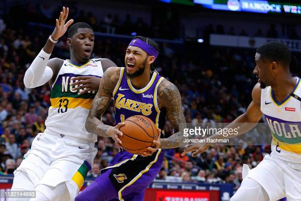 Brandon Ingram of the Los Angeles Lakers drives against Cheick Diallo of the New Orleans Pelicans and Ian Clark during the second half at the...