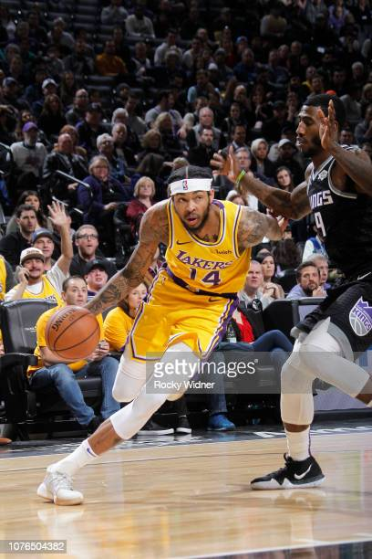 Brandon Ingram of the Los Angeles Lakers drives against Iman Shumpert of the Sacramento Kings on December 27 2018 at Golden 1 Center in Sacramento...