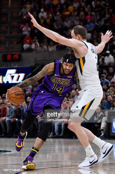 Brandon Ingram of the Los Angeles Lakers drives around Joe Ingles of the Utah Jazz in the first half of a NBA game at Vivint Smart Home Arena on...