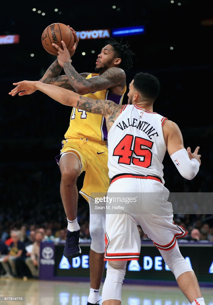 Brandon Ingram Of The Los Angeles Lakers Drives Past Denzel Valentine Of  The Chicago Bulls During