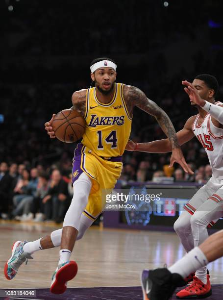 Brandon Ingram of the Los Angeles Lakers drives past Shaquille Harrison of the Chicago Bulls at Staples Center on January 15 2019 in Los Angeles...