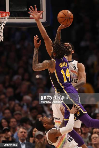 Brandon Ingram of the Los Angeles Lakers drives to the basket against Trey Lyles and Monte Morris of the Denver Nuggets in the fourth quarter at the...