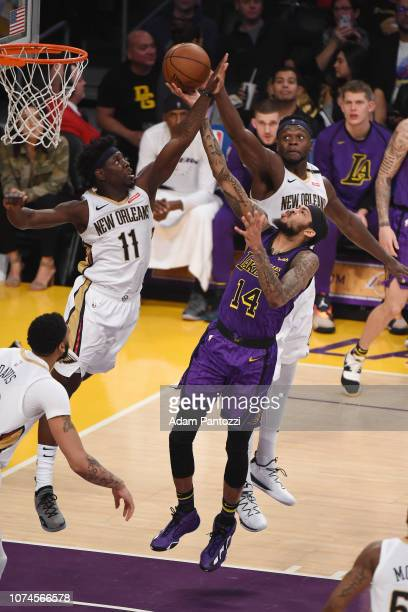 Brandon Ingram of the Los Angeles Lakers drives to the basket during the game against Jrue Holiday of the New Orleans Pelicans on December 21 2018 at...