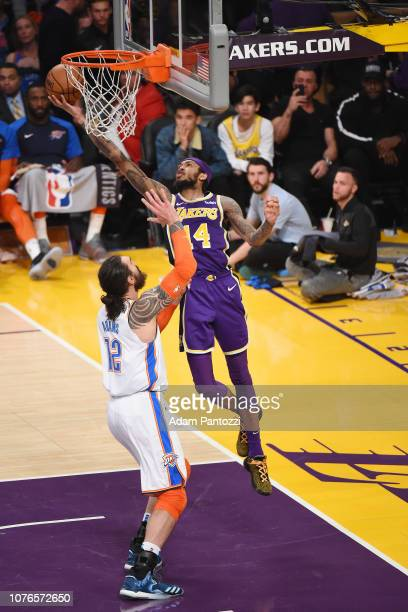 Brandon Ingram of the Los Angeles Lakers drives to the basket during the game against Steven Adams of the Oklahoma City Thunder on January 2 2019 at...